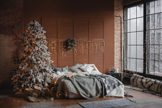 Christmas design of the bedroom. still of christmass tree in the room
