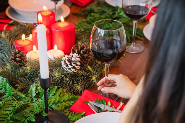 Christmas dinner concept with close up view of wine glass