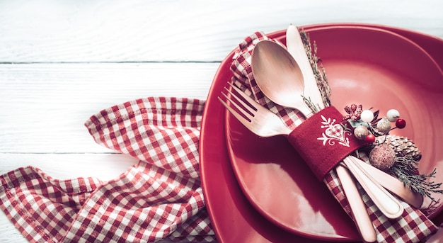 Christmas dinner cutlery on a white wooden table
