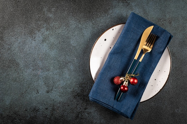 Christmas dinner cutlery with decor. christmas table place setting. new year place setting. christmas tableware with decorations. top view
