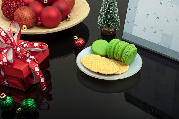 Christmas dinner table decorations with a plate of macaroons and biscuits