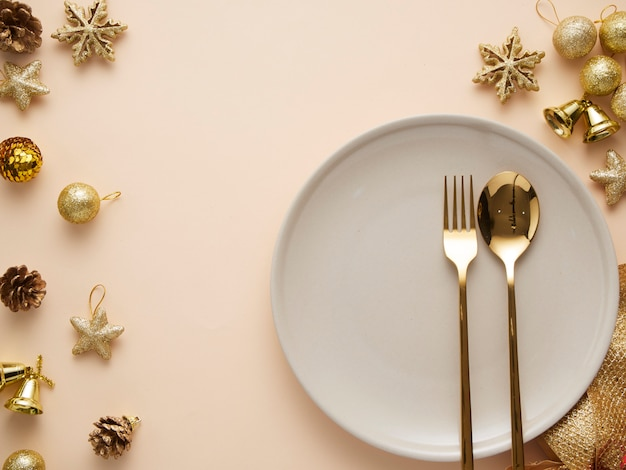 Christmas dinner table setting with gold decorations