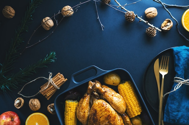 Christmas dinner table with chicken on dark