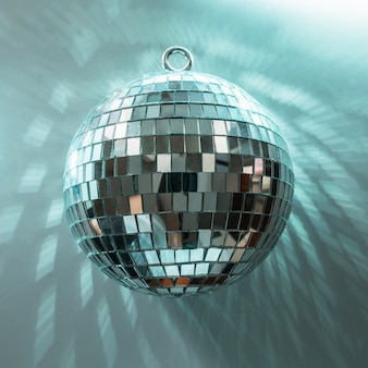 Christmas disco ball with rays on neon blue.