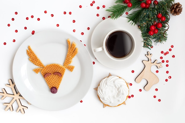 Christmas dish featuring a deer with cup coffe. flat lay
