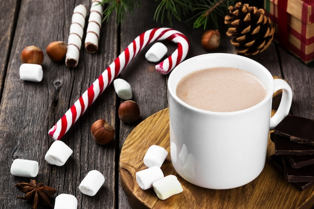 Christmas drink hot chocolate with marshmallows on wood, copy space