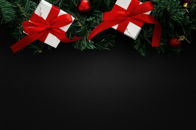 Christmas elements on black wooden background