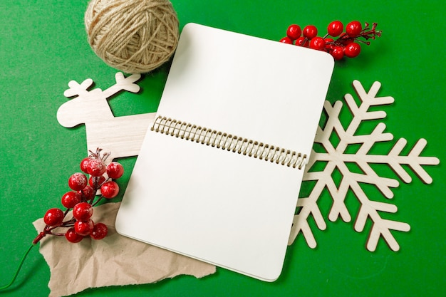 Christmas elements on green surface