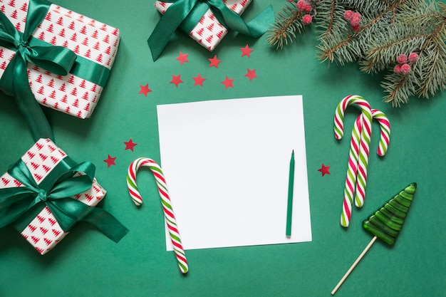 Christmas empty blank letter to santa or invitation on green. top view.