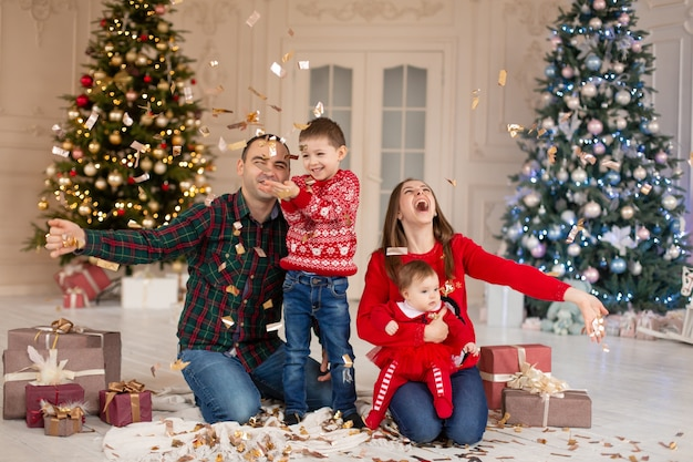 Christmas family! happy mom,dad and little daughter and son on santa claus hat