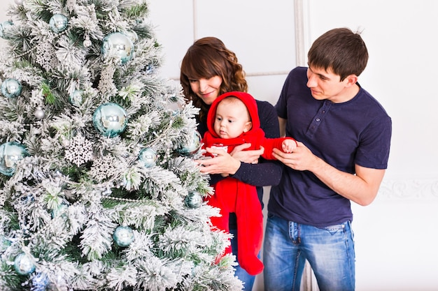 Christmas family portrait in home holiday living room, kids and dog play, present gift box, house decorating by xmas tree candles garland