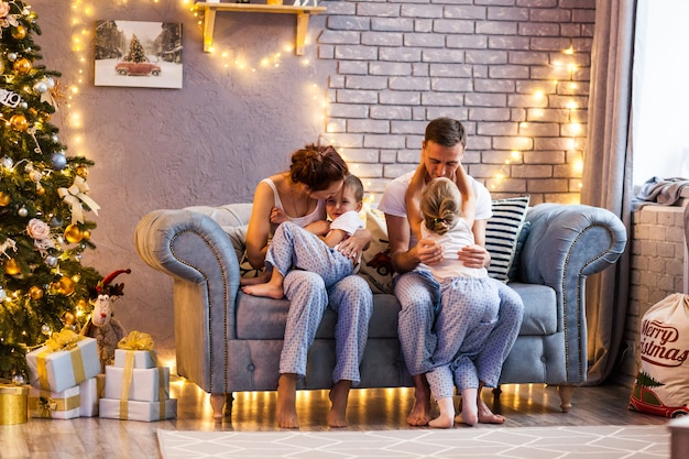 Christmas family with two kids in beautiful living room