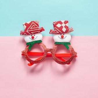 Christmas fashion party accessory on colour background