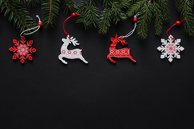 Christmas festive background with christmas tree, christmas deers, snowflakes and copy space