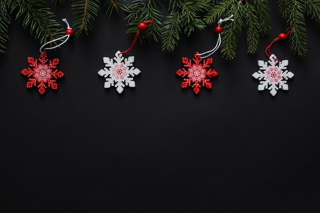 Christmas festive background with christmas tree, snowflakes and copy space for text