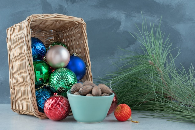 Christmas festive balls with a blue plate of nuts. high quality photo Free Photo