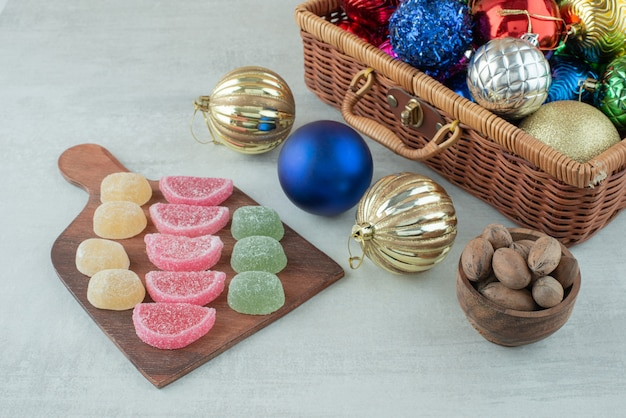 Christmas festive balls with marmalade and dried fruits on white background. high quality photo Free Photo