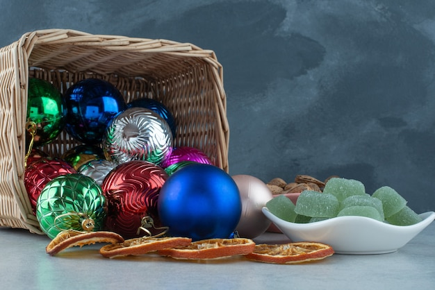 Christmas festive balls with white plate full of green marmalade . high quality photo