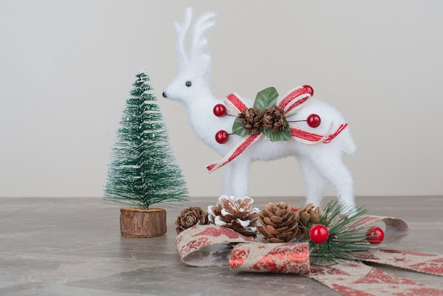 Christmas festive decorations on marble surface.