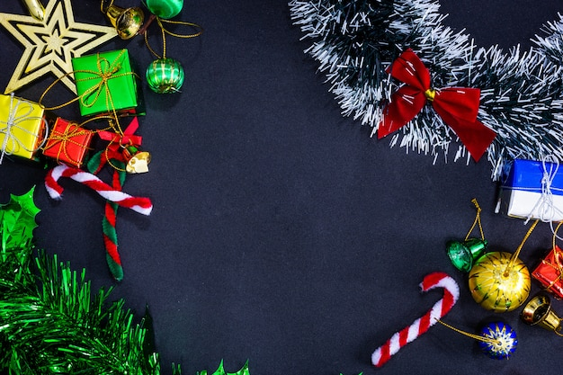 Christmas festive decorations with empty on black paper background, new year concept.