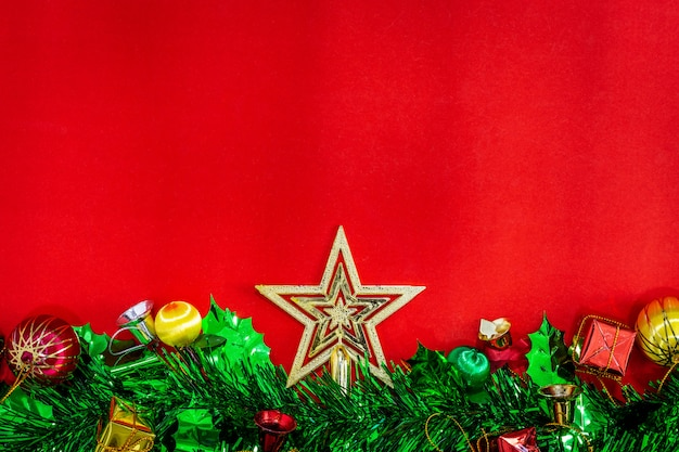 Christmas festive decorations with empty notebook and pencil on red paper background, new