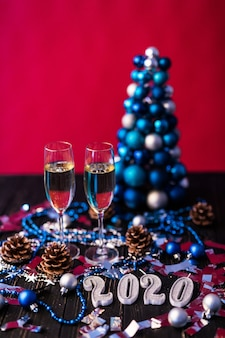 Christmas, festive mood: glass of champagne and new year's 2020 decoration