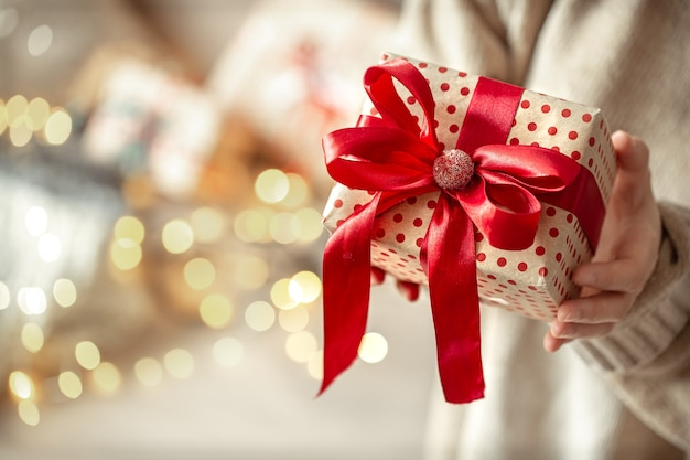 Christmas festive wall with christmas present close up. concept of gifting a present.