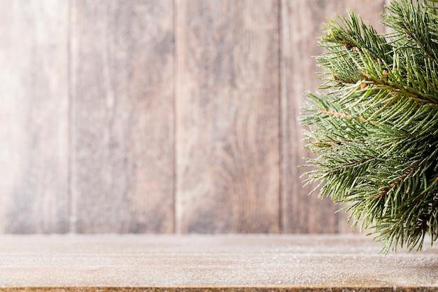 Christmas fir branch on table
