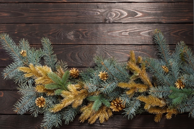 Christmas fir branches  on old dark wooden wall