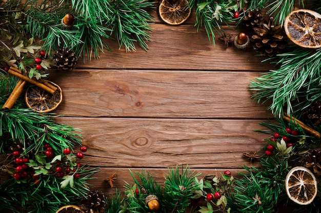 Christmas fir branches on wooden board
