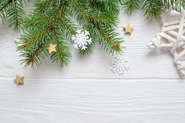 Christmas fir tree branch on white wood