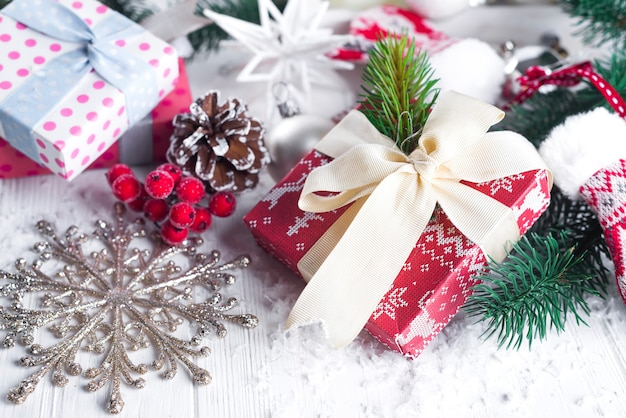 Christmas fir tree, decor, gift box and mittens