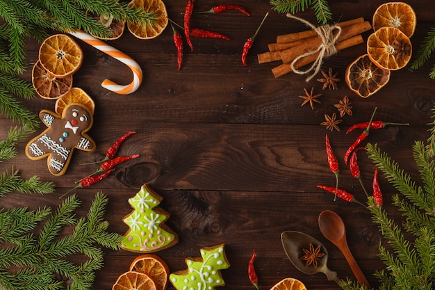 Christmas fir tree with decoration on dark wooden board in vintage style