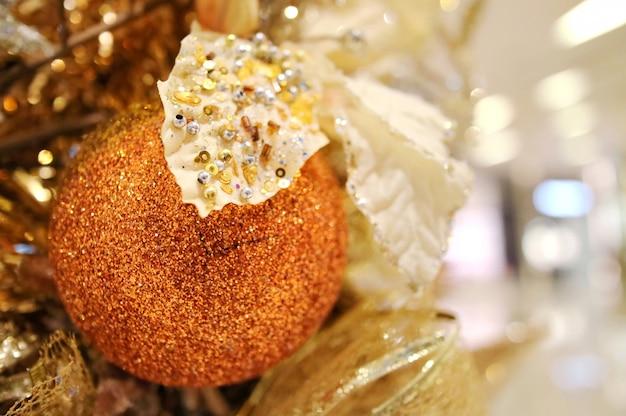 Christmas fir tree with decoration, golden ball. selective focus.