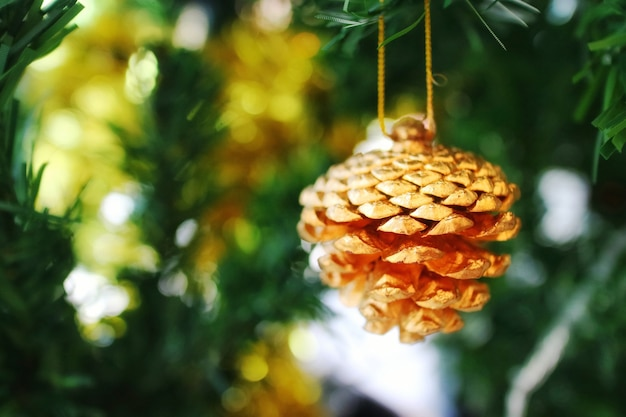 Christmas fir tree with decoration, pine seed with bokeh background.