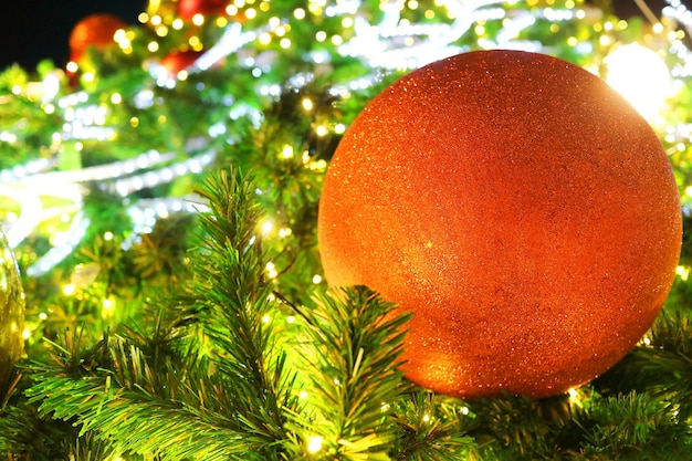 Christmas fir tree with decoration, red balls and lighting.