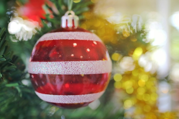 Christmas fir tree with decoration, red and white ball. selective focus.
