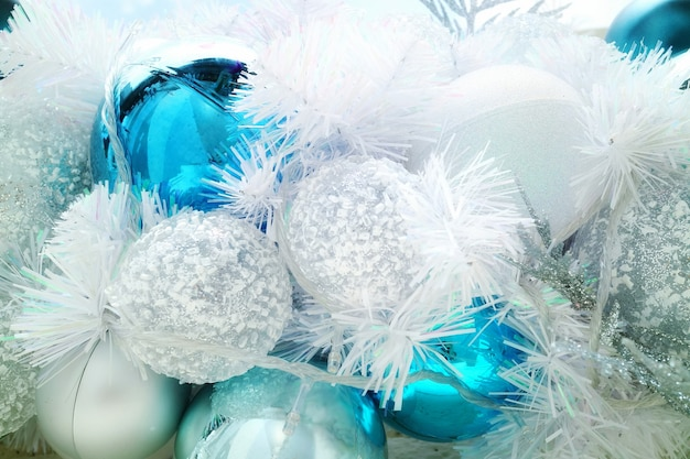 Christmas fir tree with decoration, white and blue ball with lighting.