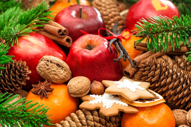 Christmas food background. apple and mandarin fruits, walnuts, cookies