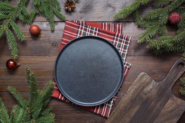 Christmas food border with black plate