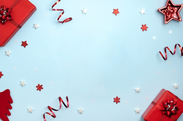 Christmas frame composition. christmas toys on pastel blue background.