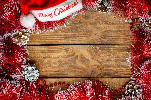 Christmas frame composition with festive ornament on wooden background. greeting card. copy space, flat lay