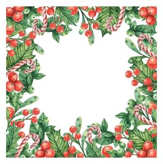 Новогодняя рамка из зеленых листьев, веток красных ягод и полосатой карамели