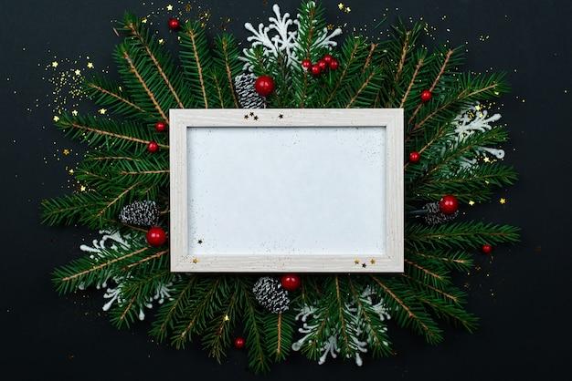 黒のグリーティングカードのクリスマスフレームのモックアップ。