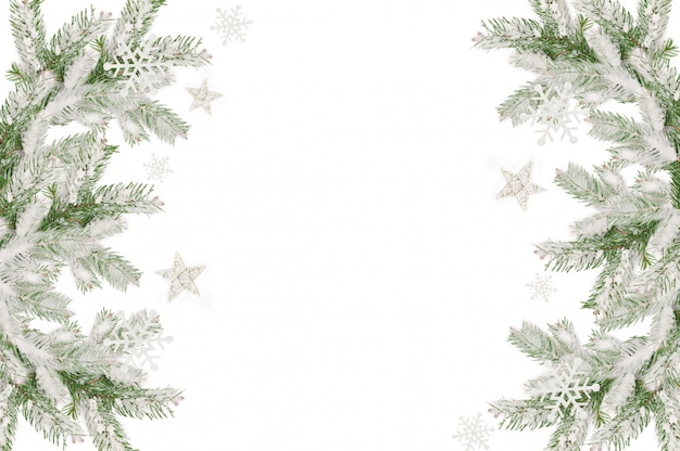 Christmas frame of snow-covered fir branches