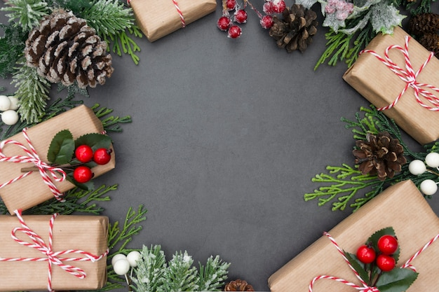 Christmas frame with gift boxes and decorations, copy space.