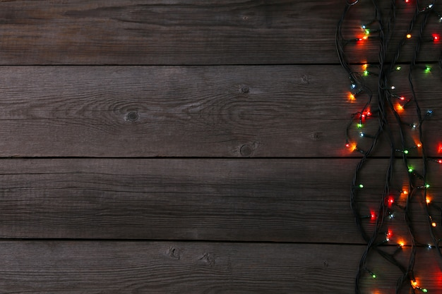 Christmas garland lights on grey background, copy space