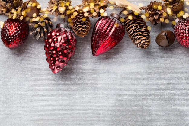 Christmas garland with red ball and grey background.
