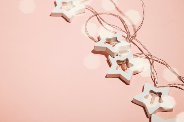 Christmas garlands on a pink background