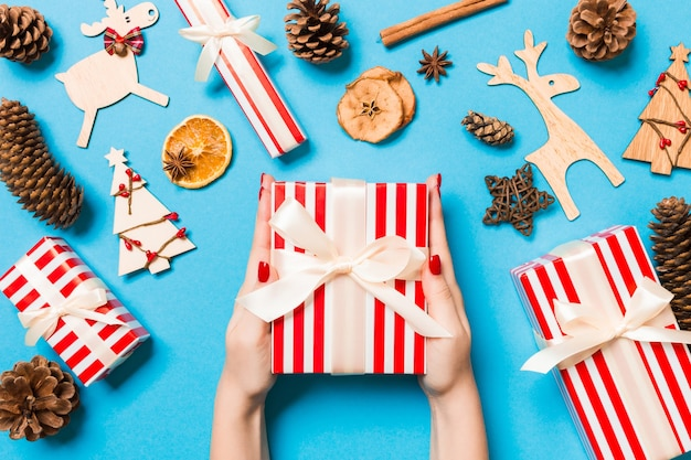 Christmas gift box on colorful background